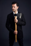 Dressed man shows an ax Stock Image