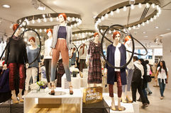 H&M store in London. Dressed mannequins in the newly remodelled  H&M flagship store in Oxford Circus in London on March 14th, 2013 Stock Photo