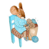 Dressed mouse knits socks Royalty Free Stock Image