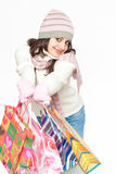 Dressed pretty woman holding bags Royalty Free Stock Images