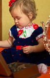 Dressed small girl plays with casket Royalty Free Stock Photo