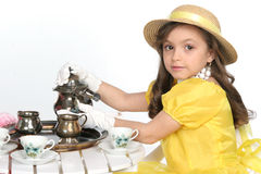 Dressed for tea. Young lady dress for tea in brite yellow with hat Royalty Free Stock Photos