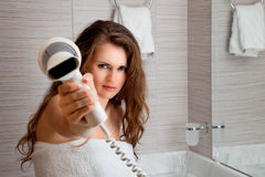 Dressed in towel beautiful woman giving you fen. At modern bathroom stock images
