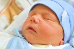 Dressed Up Baby Boy Quietly Sleeping in a Bed Royalty Free Stock Photo