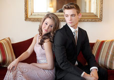 Dressed Up Teens on Couch Royalty Free Stock Image