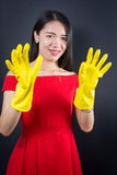 Dressed up woman with cleaning gloves Royalty Free Stock Photos