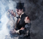 Dressed in wedding clothes romantic zombie couple.  Royalty Free Stock Image