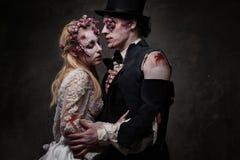Dressed in wedding clothes romantic zombie couple stock photo