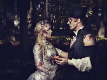Dressed in wedding clothes romantic zombie couple. Royalty Free Stock Photography