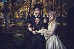 Dressed in wedding clothes romantic zombie couple. stock photo
