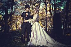 Dressed in wedding clothes romantic zombie couple. Royalty Free Stock Photo