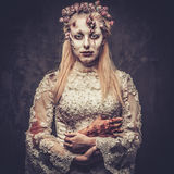 Dressed in wedding clothes romantic zombie woman. Royalty Free Stock Photography