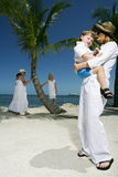 Dressed in white at the beach. Two adult women and two children, male and female, dressed in white at the beach Royalty Free Stock Image