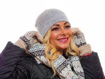 Dressed for winter. A happy smiling woman is dressed for winter looking away from the camera stock photos