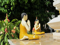 Dressed in yellow buddha statues Royalty Free Stock Image