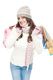 Dressed young woman with shopping bags Stock Images