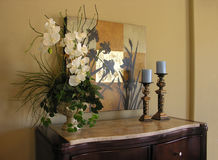 Dresser. Flowers and candles - home interior theme Stock Photos