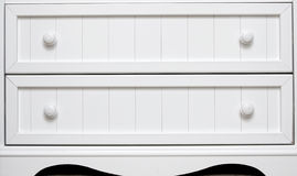 Dresser drawers. White dresser drawers with knobs Stock Photo