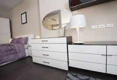 Dresser unit in bedroom of show home Royalty Free Stock Image