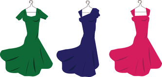 Dresses. Colored woman dresses on a white background Stock Photos
