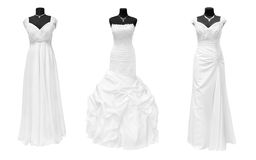 Dresses. Three wedding dresses isolated on white Stock Photo