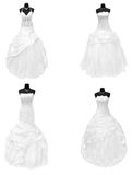 Dresses. Four wedding dresses isolated on white royalty free stock images