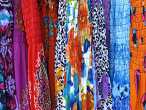 Dresses. Rack of colorful, bright printed dresses Royalty Free Stock Photo