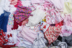 Dresses for baby girls background Stock Photo