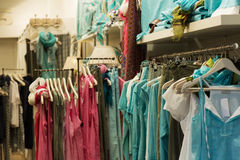 Dresses   in boutique. Blue dresses for sale in boutique Royalty Free Stock Photography