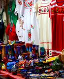 Dresses and Ceramic Crafts at Mexican Market Royalty Free Stock Images