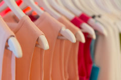 Dresses on clothes hangers. Closeup view of dresses on clothes hangers with very shallow depth of field Stock Image