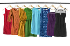 Dresses on clothes racks Stock Images