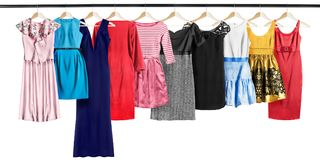 Dresses on clothes racks Royalty Free Stock Images