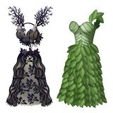Dresses in form of tree and leaves on eco theme. Two elegant dresses, simple and with feathers. Wardrobe of woman of fashion, classic collection. Image in Royalty Free Stock Photo