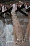 Dresses on hangers during the Eisen Stein Spring 2020 bridal presentation. NEW YORK, NY - APRIL 10: Dresses on hangers during the Eisen Stein Spring 2020 bridal royalty free stock photo