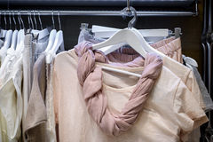 Dresses on hangers in wardrobe Stock Photography