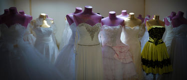 Dresses and mannequins in the back room. Dresses and mannequins awaiting sale in the back room Stock Photography