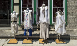 Dresses on mannequins. Outside a boutique on a sunny day Stock Photo