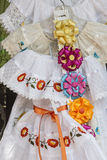 Dresses and Ribbons. Vendor display of colorful dresses and ribbons Royalty Free Stock Photos