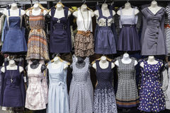 Dresses. A selection of dresses on sale on a market stall on dummys royalty free stock photo