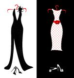 Dresses and shoes. Two women's dresses - black and white-red with shoes Royalty Free Stock Photos