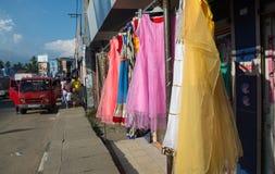 Dresses on sidewalk Royalty Free Stock Image