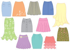 Dresses and skirts. Vector illustration of different colorful female dresses and skirts, isolated on white background Royalty Free Stock Images