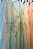 Dresses in the store. On the hangers royalty free stock image