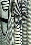 Dresses. With stripes hanging in a store Royalty Free Stock Photography