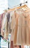 Dresses on a wooden hangers Royalty Free Stock Photos