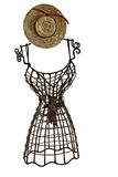 Dressform with straw hat. Miniature metallic dressform with straw hat and red ribbon isolated on white Royalty Free Stock Photography