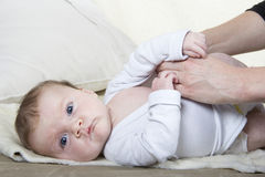 Dressing a baby Stock Photo