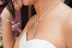 Dressing the bridal jewelry Stock Photos
