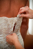 Dressing bride Stock Image